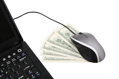 Online Earnings. A laptop computer with mouse and five one hundred dollars notes Royalty Free Stock Photos