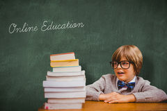 Online education against green chalkboard Royalty Free Stock Photo