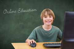 Online education against green chalkboard Stock Images
