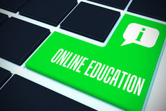 Online education against green key on black keyboard Royalty Free Stock Image