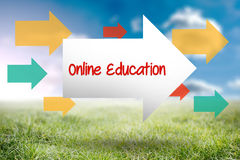 Online education against sunny landscape Stock Photo