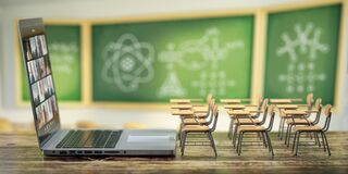 Free Online Education And E-learning Concept. Home Quarantine Distance Learning. Laptop And School Desks On Blackdesk In Classroom Stock Photos - 196755893