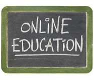 Online education blackboard sign Stock Photos