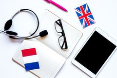 Online education concept in learning language lifestyle white ba. Online education concept in learning language lifestyle with notebook and tablet on white desk Royalty Free Stock Images