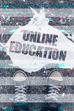Online education concept with male student feet on the street. Online education concept with young male student wearing worn sneakers standing on the street Royalty Free Stock Photo