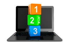 Online Education Concept. Modern Laptop with 123 toy cubes Stock Photo