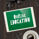 Online education concept, workspace with device Royalty Free Stock Images