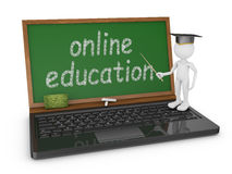 Online education. Laptop with chalk board on which is written - online education and man with a pointer Stock Photo