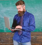 Online education. Modern technology education. Hipster teacher wear eyeglasses and necktie holds laptop. Digital. Technology education. Teacher bearded man with stock photo