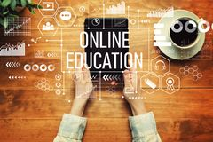 Online education with a person holding a tablet royalty free stock photos
