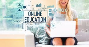 Online education with woman using a laptop royalty free stock image
