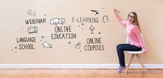Online Education with young woman holding a pen Stock Images