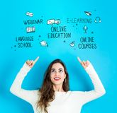 Online Education with young woman looking upwards Royalty Free Stock Photo