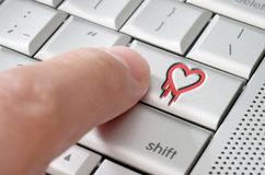 Online exploiting heartbleed bug concept. With finger on laptop keyboard Stock Photo
