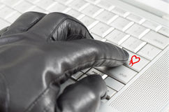 Online exploiting heartbleed bug concept. With hand wearing black glove Stock Image