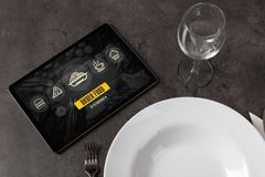Online food order concept on laid table. Online fast food order concept on a laid tablen stock photos