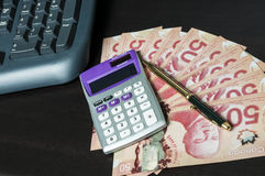 Online finance. Canadian money bill with calculator and keyboard Royalty Free Stock Photo