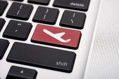 Online flight booking. Icon button of a computer keyboard Stock Photos