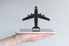 Online flight booking concept with smart phone or tablet. Stock Photo