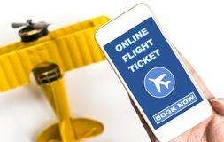 Online flight ticket book now on mobile phone Stock Photo