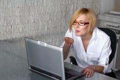 Online flirt. Blonde woman online flirt in office stock images