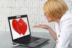 Online flirt on workplace Royalty Free Stock Photo