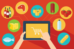 Online food shopping. Shopping online with digital tablet Royalty Free Stock Photo