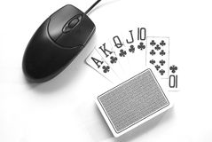 Online Gambling. Royal Flush, casino cards and one computer mouse Stock Image
