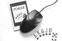 Online Gambling. Poker instruction book, royal flush and one computer mouse Royalty Free Stock Photos