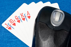 Online Gambling. A mouse resting on a royal flush stock images
