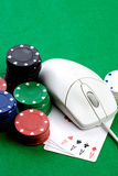 Online Gambling Concept. Online gaming and gambling concept, green felt, a mouse and cards stock images