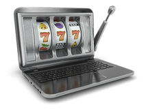 Online gambling concept. Laptop slot machine Stock Photos