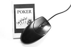 Online Gambling poker. Poker book and one computer mouse on a white isolated background Stock Photos