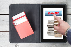 Online gambling, technology with mobile tablet Stock Photos
