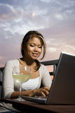 Online with glass of wine Royalty Free Stock Photography