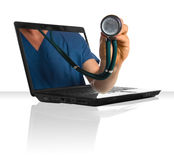 Online Health. A doctor's hand sticking out of a laptop Stock Image