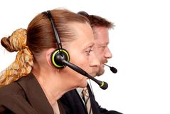 Online help, sales or support. Close-up portrait of two online sales, help or support people on an helpdesk or call center. Isolated over white stock photo