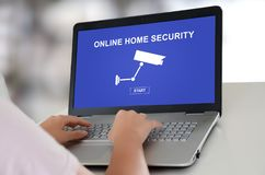 Online home security concept on a laptop. Woman using a laptop with online home security concept on the screen stock photos