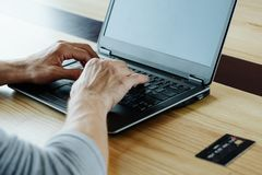 Online income earn money internet typing laptop. Online income. work on the internet and earn money from home. man hands typing on the laptop. credit or debit royalty free stock image