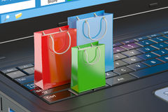 Online internet shopping concept, laptop and shopping bags Royalty Free Stock Photo