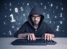 Online intruder geek guy hacking codes Stock Photography