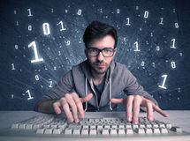 Online intruder geek guy hacking codes Stock Photography