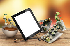 Online Japanese food delivery concept with sushi rolls on an ele Royalty Free Stock Image