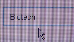 ONLINE JOB HUNTING: Macro ECU User Types 'Biotech'. Macro close up of synchronized computer monitor showing user typing the word 'Biotech' while searaching for stock footage
