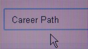 ONLINE JOB HUNTING: Macro ECU User Types 'Career Path'. Macro close up of synchronized computer monitor showing a user typing the word 'career path' while stock footage