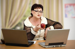 Online kiss and apple Royalty Free Stock Image