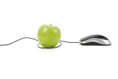 Online learning. Green apple and computer mouse, concept of online learning Royalty Free Stock Photo