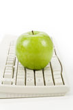 Online learning. Green apple and computer keyboard, concept of online learning Stock Photo