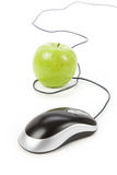 Online learning. Green apple and computer mouse, concept of online learning Royalty Free Stock Images