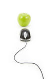 Online learning. Green apple and computer mouse, concept of online learning Stock Photography